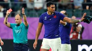 Referee Jaco Peyper shows a red card to France's Sebastien Vahaamahina during the Rugby World Cup quarterfinal against Wales. Photo: Christophe Ena/AP Photo