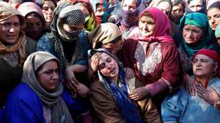 Relatives of Suhail Ahmad Wagay, who died in a gunbattle between suspected militants and Indian security forces, mourn during his funeral in Kashmir's Shopian district yesterday. Picture: Reuters/Danish Ismail
