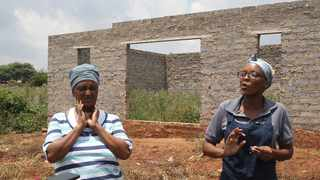 Residents Selina Motshologi and Thato Letsoalo at the unfinished building in Atteridgeville where the burnt bodies of two children were discovered. Picture: Jacques Naude/African News Agency(ANA)