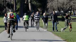 Residents exercise at Hagley Park in Christchurch. Picture: Mark Baker / AP.
