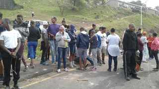 Residents of Mariannridge took to the streets in protest over land grabs. Picture: Supplied.