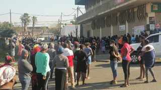 Residents stand in line outside only supermarket in Mayville which is still trading, in the hope of buying basic food items on Wednesday after shops throughout the province were looted. Picture: Nqobile Mbonambi/African News Agency (ANA)