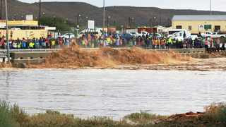 Residents watch floodwater near the Bergsig bridge in Laingsburg. Due to heavy rainfall the Karoo town has experienced its worst flooding since 1981. Photo: LAINGSBURG TOURISM