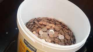 Restaurant worker gets final paycheck with bucket of 5 cent coins. Picture: Rian Keogh