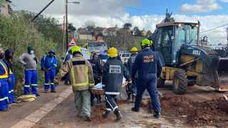Resue teams retrieved the bodies of a mother and son after a wall collapsed onto their home. Picture: RUSA
