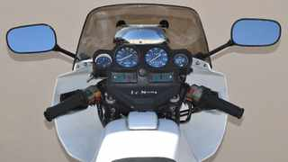 Riderscan mirror is curved through 180 degrees in the horizontal plane, so you should be able to see everything aft of your handlebars, except for the segment that is masked by your own body.