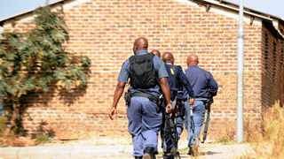 Riot police officers enter Diepkloof Hostel in Soweto to look for protesters who were blocking the road stopping cars from driving through the road adjecent to the hostel during a service protest for electricity. 070616 Picture: Boxer Ngwenya