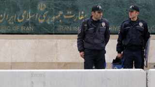 Riot police stand guard as human rights activists and lawyers demonstrate outside the Iranian Embassy in Ankara on April 7, 2015, to protest prisoners' executions and the human rights situation in Iran. Picture: AFP/ Adem Altan