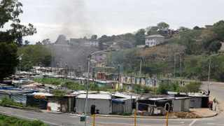 Roads were blocked with burning tyres at Quarry road informal settlement during the community protest on M19 highway in Durban. Picture: Bongani Mbatha/African News Agency(ANA)
