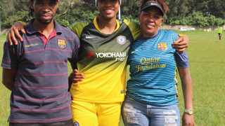 Ronnel Donnelly (centre) is a rising football star, thanks to the efforts of her parents Lewis and Thully, who also contributed to the development of other youngsters. The family is committed to using football to build a rainbow nation. Picture: Cheryl Roberts