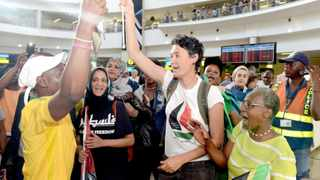 SA activist Leigh-Ann Naidoo gets a warm welcome as she arrives back in Joburg from an Israeli jail. She and 12 other activists were captured on the Women's Boat to Gaza in a bid to end the Israeli blockade of Gaza. Picture: Jacoline Schoonees