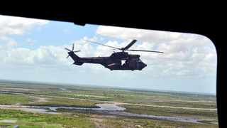 SANDF chopper is seen from another chopper flying over the devastated ares north east of Mozambique as floods devastate some parts of the country. Picture: Bongiwe Mchunu