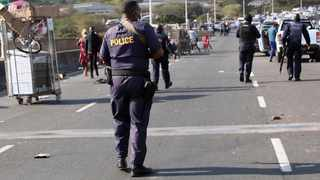 SAPS members monitor Queen Nandi Drive in the vicinity of Briardene, Riverhorse Valley, after a mob purporting to be supporters of Jacob Zuma looted the Game warehouse. Picture: Motshwari Mofokeng/African News Agency (ANA)