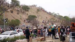 SCORES of people looted a warehouse in Queen Nandi Drive last week. Picture: Motshwari Mofokeng/African News Agency (ANA)