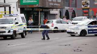 SOUTH AFRICA - Durban - 17 June 2021 - Police officers gathered and investigates one of the two crime scene were there was a shootout at First Avenue and Daly road in Durban. Picture: Motshwari Mofokeng/African News Agency (ANA)