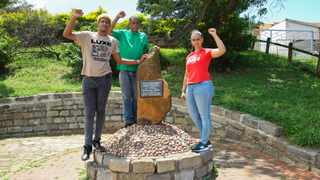 SOUTH Durban Community Environmental Alliance (SDCEA) founder Desmond D'sa, centre, celebrates the organisation's 25th anniversary with young environmental activists, Triston Meek and Shanice Firmin at the rock where former president Nelson Mandela met the Wentworth community to listen to their concerns.