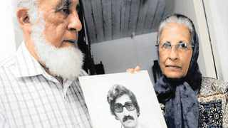 Sarah Lall and Ishmail Haffejee with a photograph of their brother, Hoosen, who died while in police detention in 1977. Picture: African News Agency (ANA)