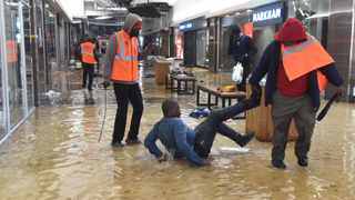 Security at the Chris Hani Mall in Vosloorus forced looters to swim in the water on the ground, which was released by the sprinklers in the midst of the looting. The swimming served as a punishment for their attempt to loot more stores in the Mall.Picture: Itumeleng English/African News Agency(ANA)