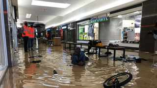 Security guards at the Chris Hani Mall in Vosloorus force looters to swim in the water released by the sprinkler system. Picture: Itumeleng English/African News Agency(ANA)