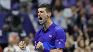 Serbia's Novak Djokovic reacts after winning his 2021 US Open Tennis tournament men's semifinal match against Germany's Alexander Zverev at the USTA Billie Jean King National Tennis Center in New York, on September 10, 2021. (Photo by Kena Betancur / AFP)
