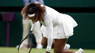 Serena Williams reacts after sustaining an injury during her first round match at Wimbledon. Photo: Peter Nicholls/Reuters