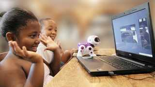 Seven-year-old Ayamaah Mazibuko, who is in Grade 1 at Maris Stella, takes part in an online lesson, while her brother, Nkanyezi Mazibuko, 10, in Grade 4 at Durban Preparatory School, looks on, at their Westville home yesterday. File Picture: Doctor Ngcobo  African News Agency (ANA)