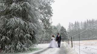 Simone and Jarryd Aricksamy had an unexpected white wedding when it snowed in the KZN Midlands on Saturday. Picture Stuart Dods.