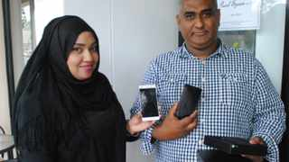 Siraaj Abrahams, 41, getting a new Huawei P9 Light from Huaweis Hawa Hyath. Picture: Patrick Louw
