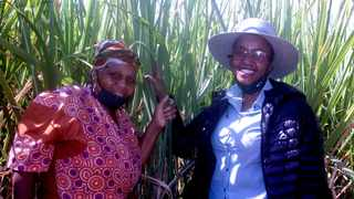 Small-scale grower, Nomsa Mkhize with SA Cane growers' Agriculture Business Advisor for the KwaZulu-Natal Midlands region in her field of N12 variety seedcane which will not only improve her yields but sustain the viability of her 0.8ha operation.