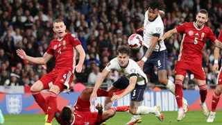Soccer Football - World Cup - UEFA Qualifiers - Group I - England v Hungary - Wembley Stadium, London, Britain - October 12, 2021 Hungary's Attila Szalai in action with England's John Stones Action Images via Reuters/Carl Recine