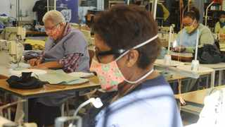 Social distancing is practiced by seamstresses working on sewing machines at Coconut Jazz while they produce cloth masks. Picture: African News Agency(ANA)