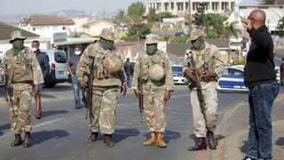 Solider patrolling near the Phoenix police station this week. Picture: Bongani Mbatha /African News Agency (ANA)