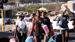 Some of the alleged KwaZulu Natal looters with with their loot. Picture: Motshwari Mofokeng/African News Agency (ANA)