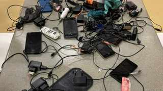 Some of the cellphones and chargers found at the Qalakabusha Maximum Correctional Centre in Empangeni, during a surprise raid on Tuesday. Picture: Supplied