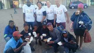 Some people who received food parcels from CCLewis Helping Hands Charity. Picture: Supplied