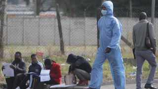 South Africa Durban - 2 JULY 2020 -Coronavirus Zamokuhle Mhlongo walking on the street wearing Covid-19 protective gear after fetching it from the dust bin to protect himself from cold in Durban.PICTURE :Bongani Mbatha /African News Agency (ANA)