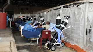 South Africa - Pretoria - 11 January 2021. Steve Biko Academic Hospital health workers attending to patients at the parking lot which has been convernted in to a ward due to shortage of space in the hospital.Picture: Oupa Mokoena/African News Agency(ANA)