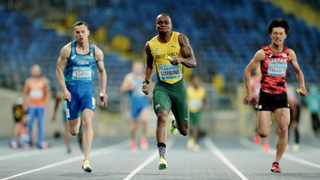 South Africa's Akani Simbine in action on his way to winning the Men's 4x400 Metres Relay final. Photo: Aleksandra Szmigiel/AFP
