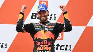 South Africa's Brad Binder celebrates on the podium after winning the Austrian Motorcycle Grand Prix at the Red Bull Ring race track in Spielberg, Austria on Sunday. Photo: Joe Klamar/AFP