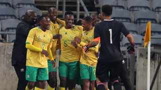 South Africa's Evidence Makgopa celebrates with teammates after scoring one of his two goals during their international friendly match against Uganda at Orlando Stadium in Johannesburg on Thursday. Photo: Samuel Shivambu/BackpagePix