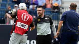 South Africa's Louis Oosthuizen shakes hands with Republic of Ireland's Shane Lowry's caddie on the eighteenth hole during the first round of the British Open on Thursday. Photo: Rebecca Naden/Reuters