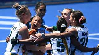 South Africa's Marizen Marais (L) celebrates with teammates after scoring against India during their women's pool A match of the Tokyo 2020 Olympic Games. Photo: AFP