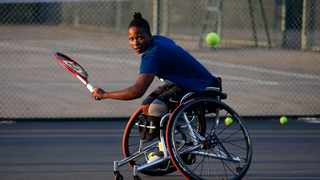 South Africa's No1 wheelchair tennis player and the first African wheelchair tennis player to compete in all four Majors in a calender year, Kgothatso Montjane, plays a backhand shot during a training session at the High Performance Centre in Pretoria on April 13, 2021. 'KG' as she is affectionately known, made history in 2018 when she became the first ever black South African woman to compete at Wimbledon. She is now looking to snatch a medal at the Paralympics in Tokyo. Photo: Phill Magakoe/AFP