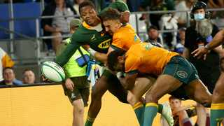 South Africa's Sbu Nkosi is tackled by Australia's Nic White (C) and Marika Koroibete during the Rugby Championship match. Photo: Patrick Hamilton/AFP