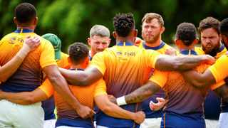 South Africa's players huddle at the start of captain's run in Townsville. Photo: Patrick Hamilton/AFP