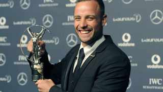 South African Oscar Pistorius poses for photographs with his award at the 2012 Laureus World Sports Awards in London.