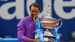Spain's Rafael Nadal celebrates with the trophy after winning the ATP Barcelona Open. Photo: Josep Lago/AFP