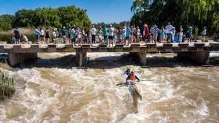 Spectators watch paddlers taking part in the first day of the 2021 Fish River Canoe Marathon on Friday. Picture: Bruce Viaene/Gameplan Media