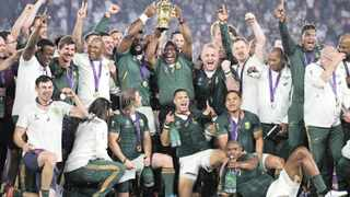 Springbok captain Siya Kolisi lifts the Webb Ellis Cup with President Cyril Ramaphosa after the Boks defeated England to win the Rugby World Cup in Japan on Saturday. Picture: Christophe Ena/AP