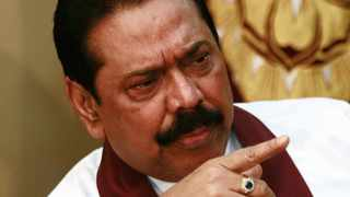 Sri Lanka's President Mahinda Rajapaksa points during a meeting with the international media in Colombo January 27, 2010. Rajapaksa won re-election on Wednesday in an historic post-war vote but his chief rival, General Sarath Fonseka, called for the results to be nullified after soldiers surrounded him in a luxury hotel. REUTERS/Andrew Caballero-Reynolds (SRI LANKA - Tags: POLITICS ELECTIONS)